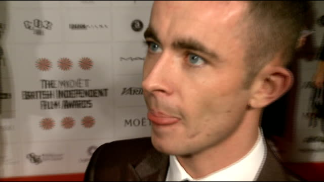 British Independent Film Awards 2012 arrivals Peter Strickland red carpet interview SOT Edit Bowman talking to press on red carpet Paul Brannigan red...