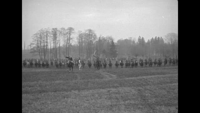[film by pathe's george ercole] russian cavalry charges across field with swords drawn to and past camera as they approach przemsyl, austria / group... - austria video stock e b–roll