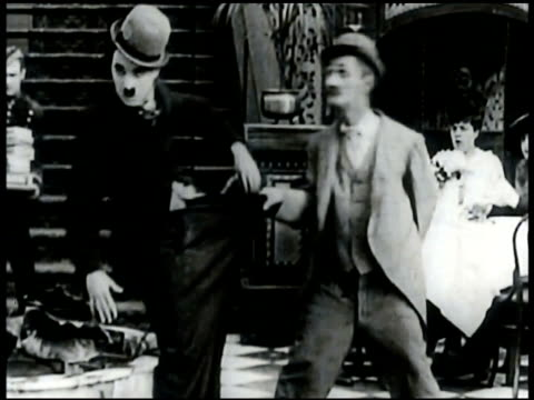 film can 'his night out' clip w/ charles chaplin & ben turpin staggering together chaplin having altercation at table w/ couple chaplin brushing... - brushing teeth stock videos & royalty-free footage