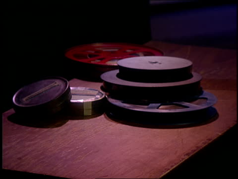 film canisters and a bowl of popcorn sit on a table. - film container stock videos & royalty-free footage