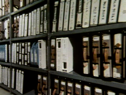 Film cans and video tapes line the shelves of the BBC's television archive