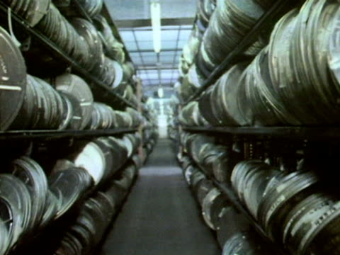 film cans line the shelves of the bbc's television archive. - television show stock videos & royalty-free footage