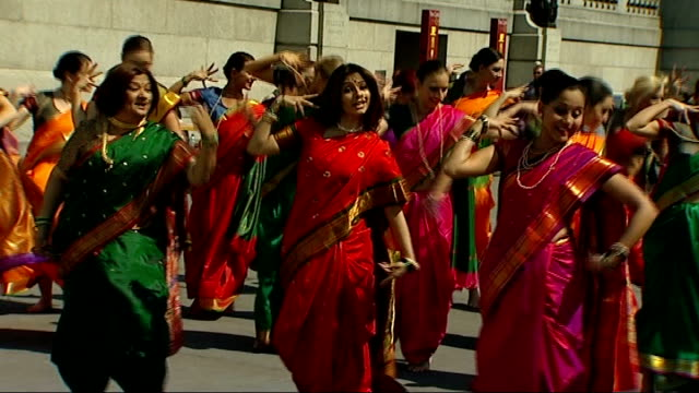 centenary of indian film england london trafalgar square heard** various of bollywood dancers performing dance routine in trafalgar square sot - bollywood stock videos and b-roll footage