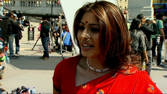 centenary of indian film tanisha mukherjee interview sot female dancers sitting around trafalgar square fountain as filming scene from bollywood film... - bollywood stock videos and b-roll footage
