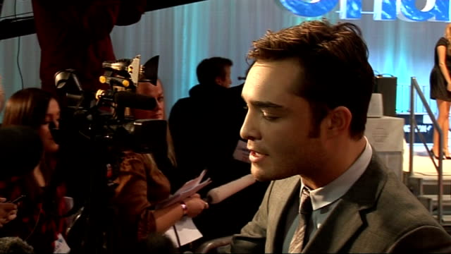 'chalet girl' premiere celebrity arrivals ed westwick fans laughing / back view of charlotte dutton posing / side views of ed westwick speaking to... - season 4 stock videos and b-roll footage