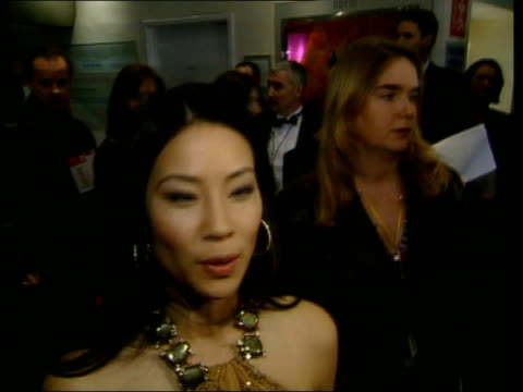 vídeos de stock, filmes e b-roll de 'charlie's angels' prince charles meets drew barrymore and lucy liu england london leicester square actor lucy liu towards into cinema foyer lucy liu... - tom green