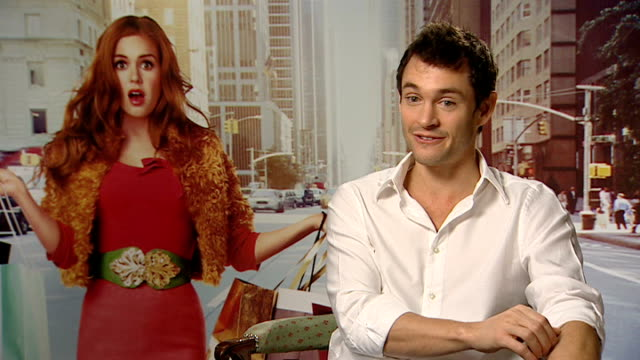 'confessions of a shopaholic' interviews; dancy interview sot - on ad-libbing in the film / on how hard isla worked / on valentine's day - not with... - shopaholic stock-videos und b-roll-filmmaterial