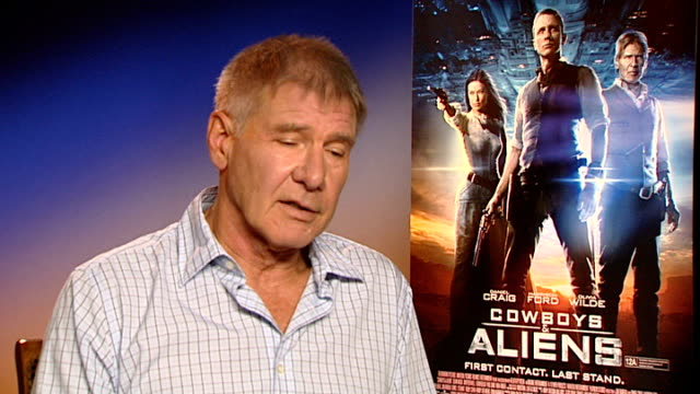 'cowboys and aliens' harrison ford and daniel craig interview ford interview sot craig interview sot - cowboys & aliens stock videos and b-roll footage
