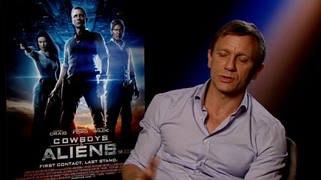 'cowboys and aliens' harrison ford and daniel craig interview craig interview sot - cowboys & aliens stock videos and b-roll footage