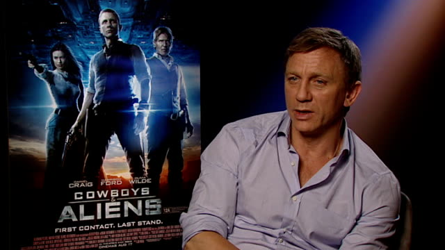 'cowboys and aliens' harrison ford and daniel craig interview craig interview sot - daniel craig stock videos and b-roll footage