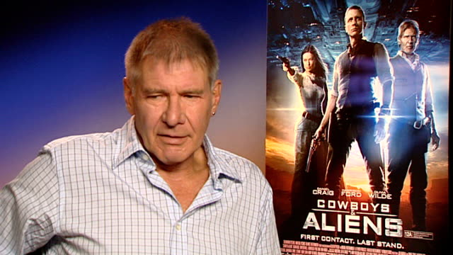 'cowboys and aliens' harrison ford and daniel craig interview england london int harrison ford interview sot - cowboys & aliens stock videos and b-roll footage