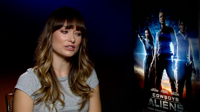 'cowboys and aliens' olivia wilde interview england london int olivia wilde interview sot men very encouraging they liked her character very... - cowboys & aliens stock videos and b-roll footage