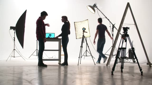 film crew in the studio - camera photographic equipment stock videos & royalty-free footage
