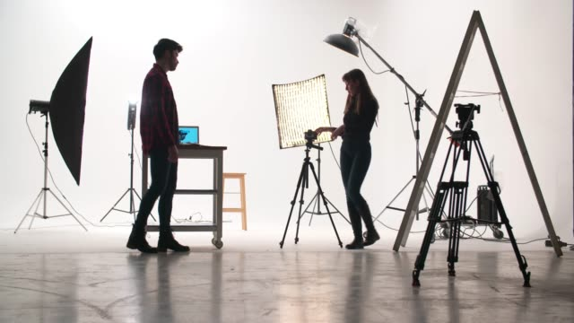 film crew in the studio - photo shooting stock videos and b-roll footage