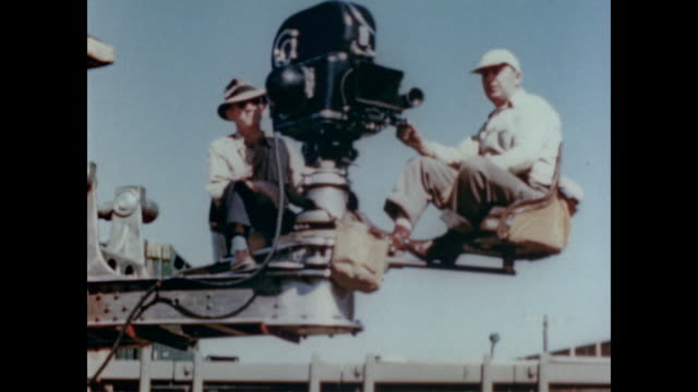 1947 film crew use crane to get interesting shots on film set - film director stock videos & royalty-free footage