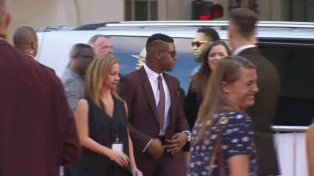 'detroit' premiere ext john boyega arriving at 'detroit' premiere will poulter signing autographs for fans john boyega and kathryn bigelow posing on... - autographing stock videos & royalty-free footage