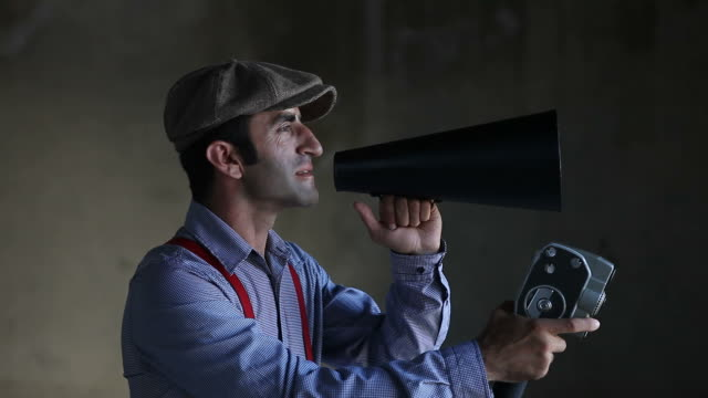 film director in old fashioned clothes holding camera and megaphone - film studio stock videos and b-roll footage