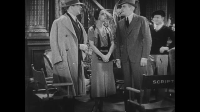 1931 film director lowell sherman directs actress claudia dell before being interrupted by police inspector (eddie kane) who is mistaken as an actor - film director stock videos and b-roll footage