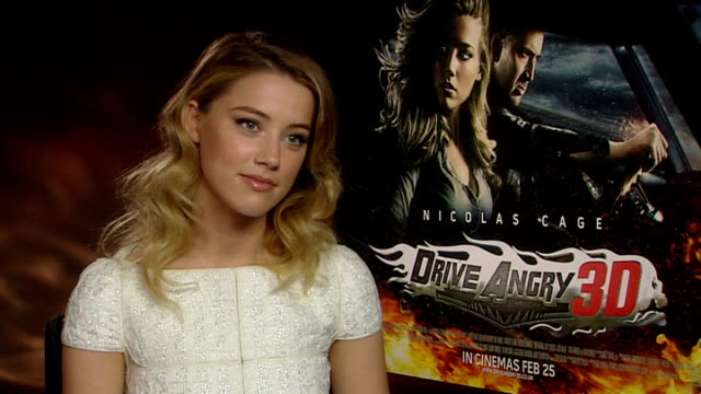 'drive angry 3d' interview with amber heard england london int amber heard interview talks about her role alongside nicolas cage in the new film... - amber heard stock videos & royalty-free footage