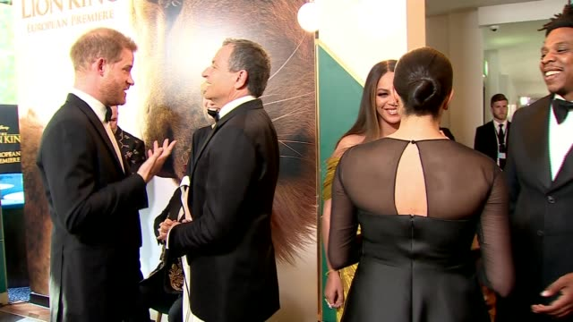 stockvideo's en b-roll-footage met duke and duchess of sussex attend premiere for the lion king england london leicester square int prince harry duke of sussex chatting with robert ige... - première