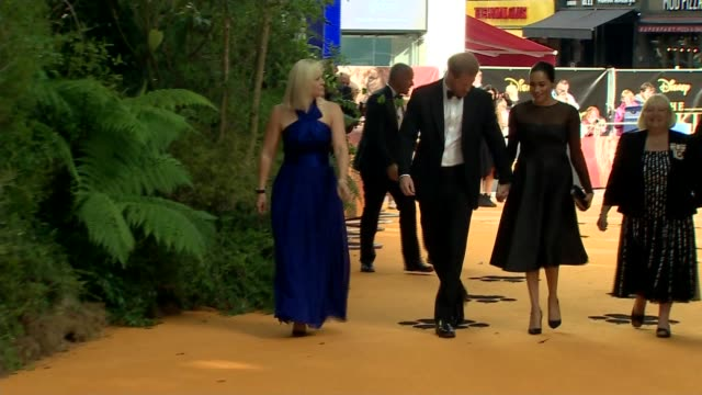 duke and duchess of sussex attend the lion king premiere; england: london: leicester square: ext prince harry, duke of sussex and meghan, duchess of... - red carpet event stock videos & royalty-free footage