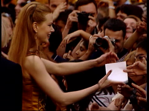 'eyes wide shut' premiere england london actress nicole kidman meeting fans outside cinema ms actor tom cruise along meeting fans outside cinema - nicole kidman stock videos & royalty-free footage