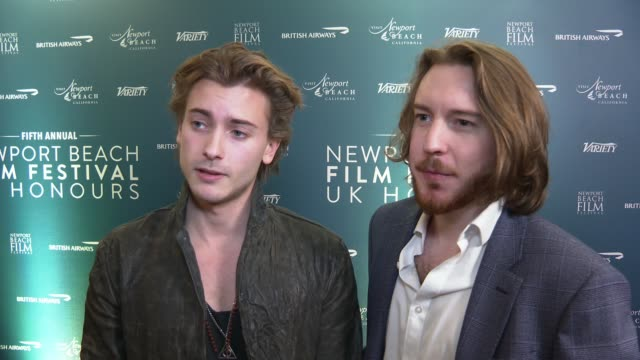 fifth annual newport beach film festival uk honours; england: london: the langham hotel: int thomas beatty posing for photocall / elijah rowen and... - film festival stock videos & royalty-free footage