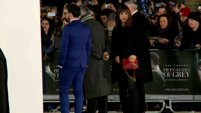 'fifty shades of grey' premiere red carpet arrivals england london ext **music heard sot** fans behind barriers some dancing and cheering sot / film... - autographing stock videos & royalty-free footage