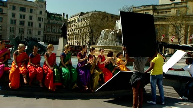 filming of bollywood movie 'anntar' in trafalgar square england london trafalgar square ext **music heard intermittently sot** female dancers around... - bollywood stock videos and b-roll footage