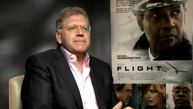 'flight' junket interviews england london int robert zemeckis interview sot / kelly reilly interview sot - robert zemeckis stock videos and b-roll footage