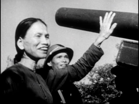 film from north vietnam depicting civilian life and armed conflict during the vietnam war - vietnamkrieg stock-videos und b-roll-filmmaterial