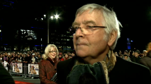 gambit' london premiere **music heard intermitently sot** people along on red carpet tom courtenay interview sot anthony costa signing autographs - tom courtenay stock videos & royalty-free footage