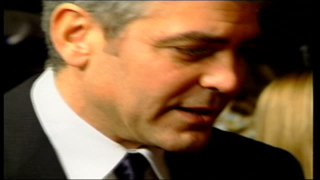 george clooney attacked by rightwing critics lib england london ext george clooney arriving at bafta awards ceremony - george clooney stock videos and b-roll footage