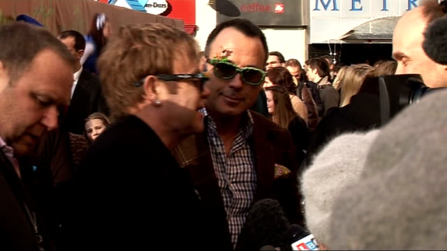 Gnomeo and Juliet Premiere red carpet arrivals Sir Elton John and David Furnish partner of pop singer Elton John talking to press / Elton John and...