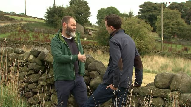 'gods own country' director francis lee interview england yorkshire int francis lee interview with reporter in shot sot fields in countryside - film director video stock e b–roll