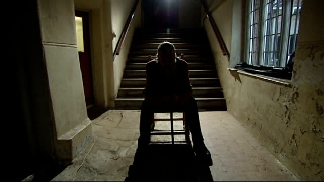 graphic novel writer alan moore makes own film; england: northampton: delapre abbey: int alan moore sitting in corridor zoom in - northampton england stock videos & royalty-free footage