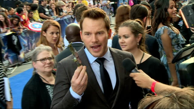 'guardians of the galaxy' european premiere chris hemsworth signing autographs / chris pratt talking to a toy groot / mark hamill / joss whedon... - position stock-videos und b-roll-filmmaterial