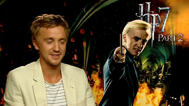 'harry potter and the deathly hallows part two': interviews with cast members; tom felton interview sot - on his character draco malfoy and enjoying... - harry potter titolo d'opera famosa video stock e b–roll