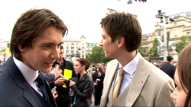 'harry potter and the deathly hallows part two' premiere celebrity interviews james and oliver phelps interview sot on their outfits / the premiere /... - oliver phelps stock videos & royalty-free footage