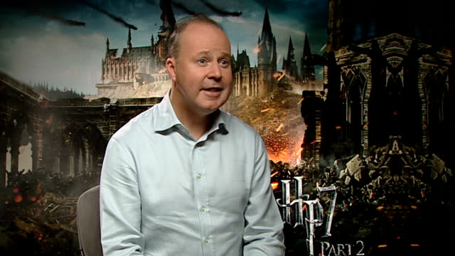 'harry potter and the deathly hallows part two' world premiere; david yates interview sot - harry potter titolo d'opera famosa video stock e b–roll