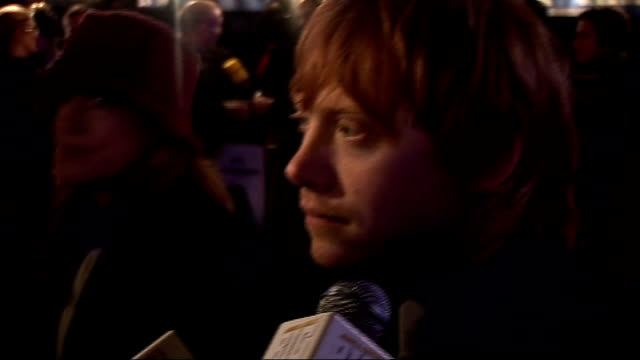'harry potter and the deathly hallows' world premiere: celebrity arrivals; rupert grint interview sot - on the end of harry potter - doesn't know how... - last day stock videos & royalty-free footage