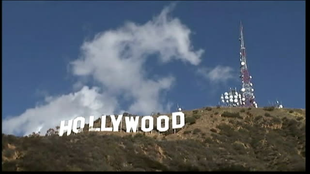 Hollywood film industry struggling USA California Los Angeles Hollywood SEQUENCE 'Hollywood' film sign on hillside with clouds passing overhead Long...