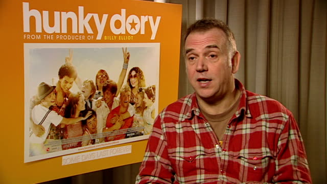 'hunky dory' minnie driver and marc evans interviews marc evans interview sot on loving working with the kids on whether or not it reminded him of... - minnie driver stock videos and b-roll footage