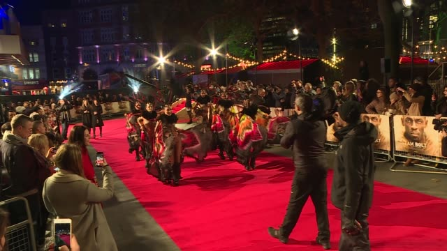 am bolt' documentary film premiere; england: london: leicester square: ext / night 'i am bolt' movie poster / dancers on red carpet / usain bolt with... - documentary film stock videos & royalty-free footage