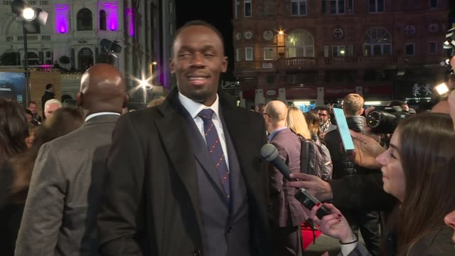 am bolt' documentary film premiere; england: london: leicester square: ext / night various shots usain bolt chatting with fans on red carpet - documentary film stock videos & royalty-free footage