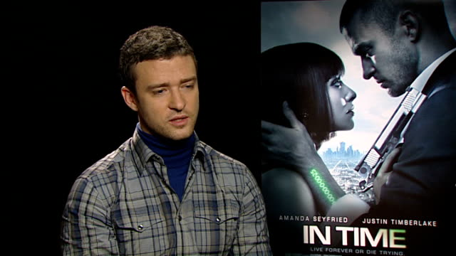 'in time' premiere interviews with amanda seyfried and justin timberlake justine timberlake interview sot on why he chose this film intriguing... - justin timberlake stock-videos und b-roll-filmmaterial