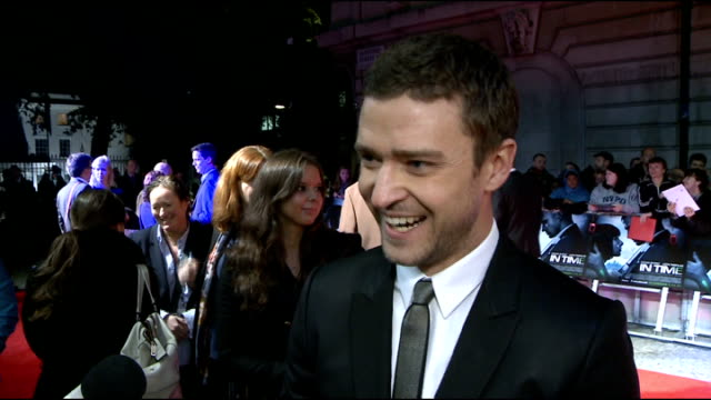 'in time' premiere: red carpet interviews; timberlake embraces reporter & pretends to know her sot / justin timberlake interview sot - is it ok to... - justin timberlake stock videos & royalty-free footage