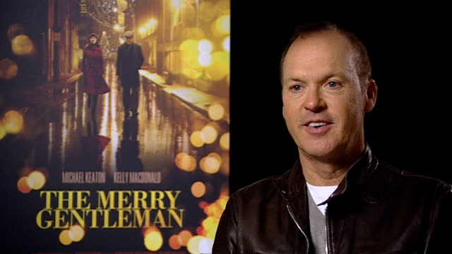interview with michael keaton; england: london: int michael keaton interview sot - banter about elvis costello song 'alison' / what it was like... - elvis costello stock-videos und b-roll-filmmaterial