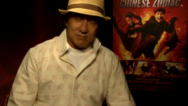 Jackie Chan interview Chan interview SOT Describes stunt on watching his own stunts back I'm proud very lucky I've got to do it send my JC team to...