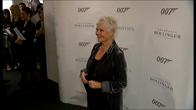 james bond 50th anniversary celebrated **beware dame judi dench posing for photocall dame judi dench interview sot - judi dench stock videos & royalty-free footage